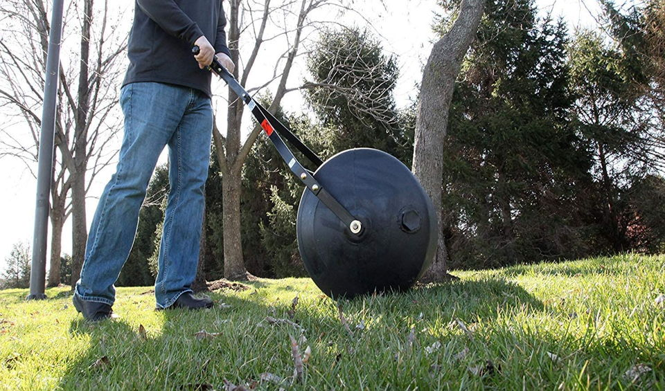 What is a lawn roller used for