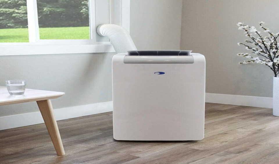 Portable air conditioner with condensate pump